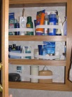 Elastic strip storage for medicine cabinet
